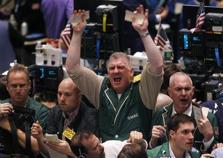 Traders gesture at each other while working in the crude oil and natural gas options pit on the floor of the New York Mercantile Exchange