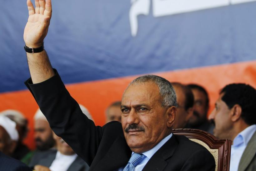 Yemen's President Saleh waves to supporters gathered in a soccer stadium in Sanaa