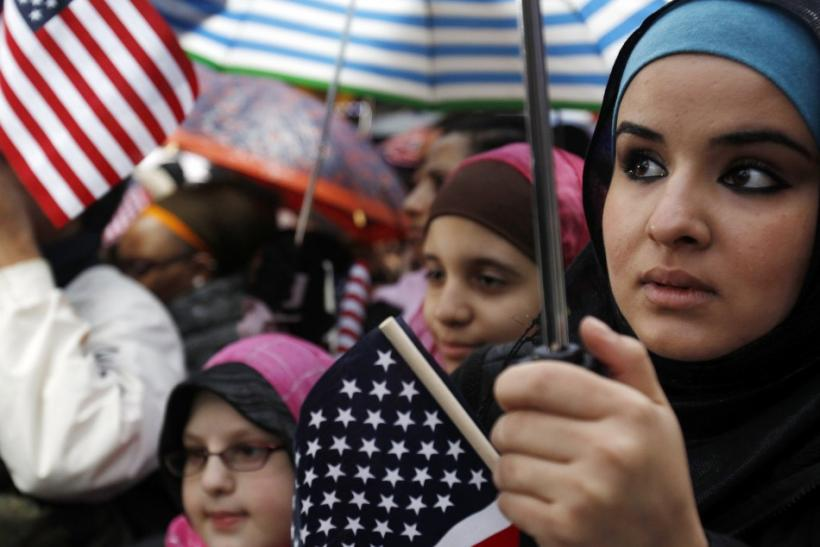 "Zienib Noori, 20, of Albany, NY listens to a speaker at the ""Today, I Am A Muslim, Too"" rally in New York City"