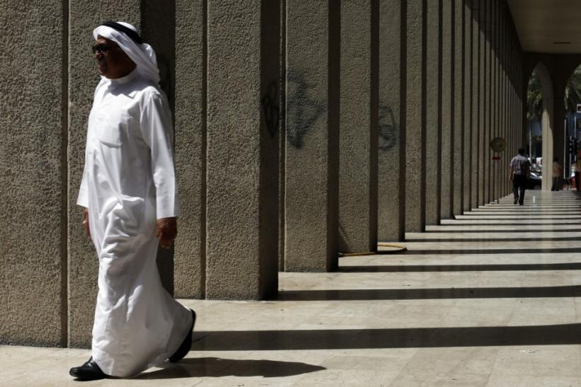 A man walks near the Bahrain Financial Harbour in Manama