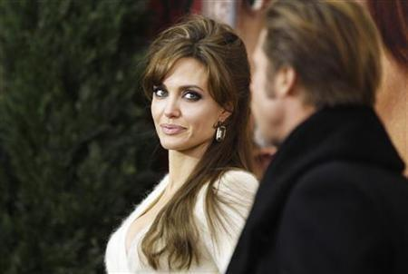 """Cast member Angelina Jolie arrives with Brad Pitt for the premiere of ''The Tourist"""""""