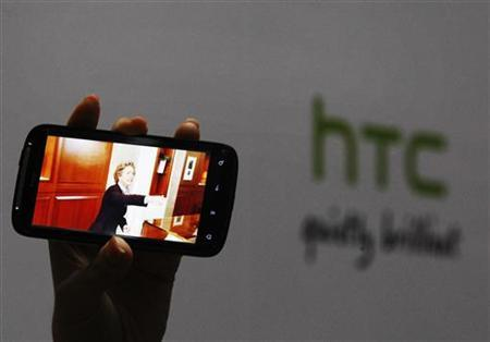 "A new HTC Android-based smartphone ""Sensation"" is displayed during a news conference for the launch of the product in Taipei"