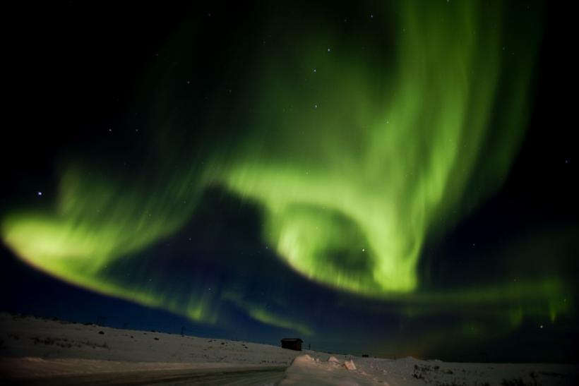 Aurora borealis fill the sky over Finnmark during the 1000 km long Finnmarkslopet, world's northernmost sled dog race, taking place in Finnmark county, northern Norway on March 13, 2011.