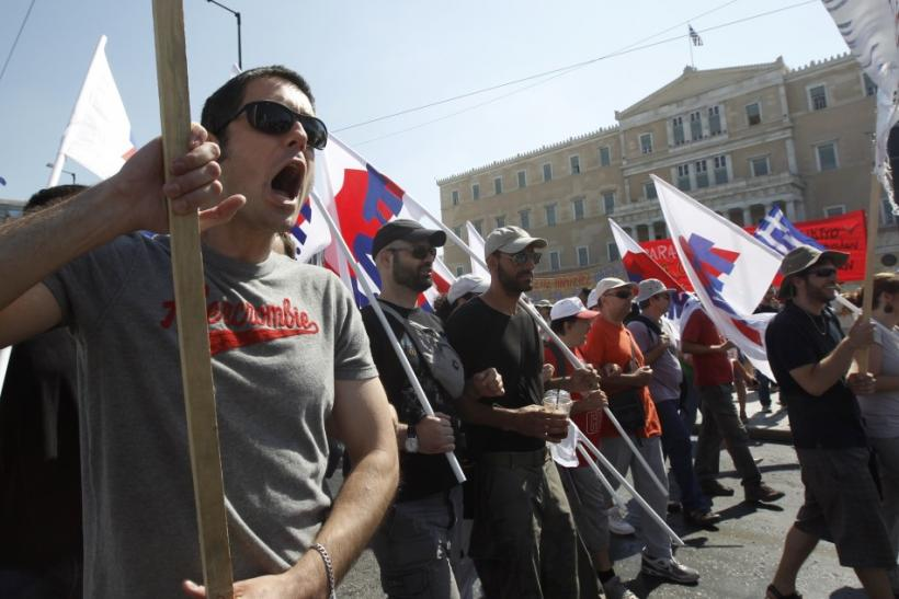 Demonstrators march in protest against austerity measures in front of the Greek parliament in Athens