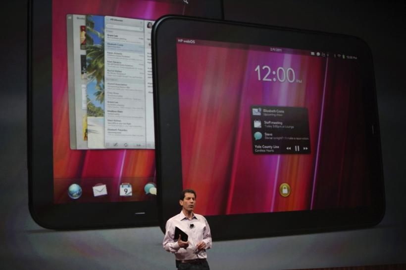 Jon Rubinstein, senior vice president and general manager for Palm, holds the Palm TouchPad during a media presentation
