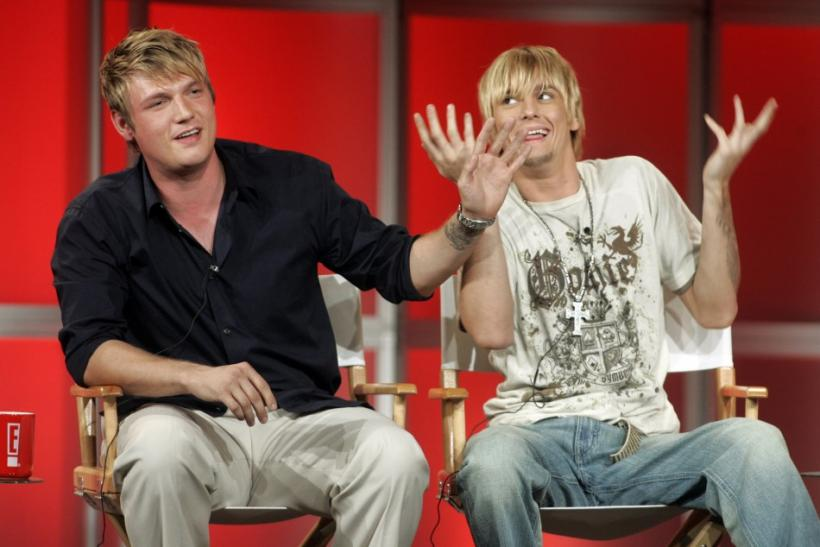 Singers and brothers Nick (L) and Aaron Carter answer questions about their new reality television program 'House of Carters' which features them and their three sisters on E! Networks during a session at a Cable Television Critics Association p
