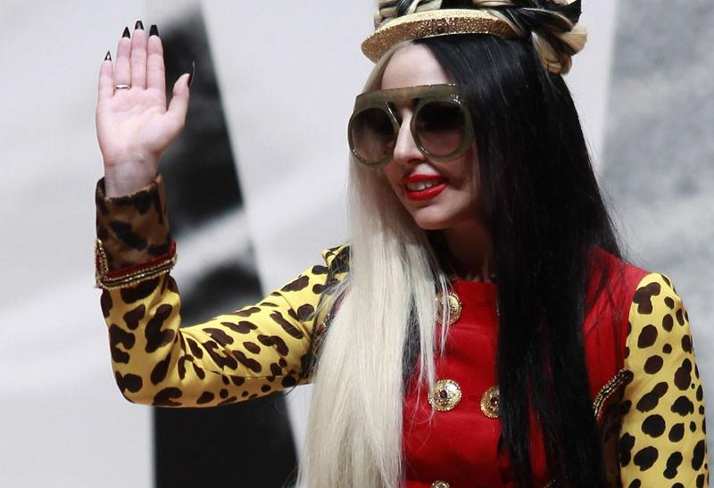 U.S. singer Lady Gaga waves as she arrives for the welcoming ceremony in Taiwan