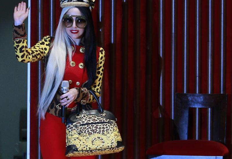 Lady Gaga waves as she arrives for the welcoming ceremony in Taiwan
