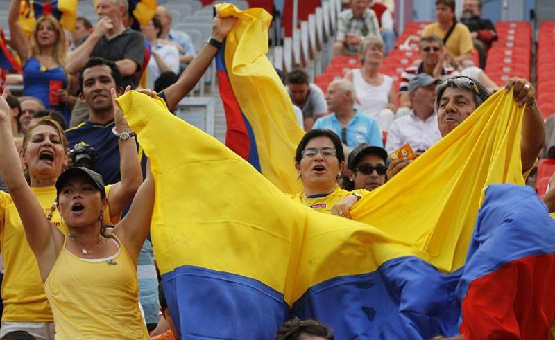 Colombian soccer fans cheer for their team