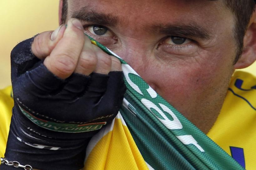 Europcar rider Thomas Voeckler of France kisses the yellow jersey