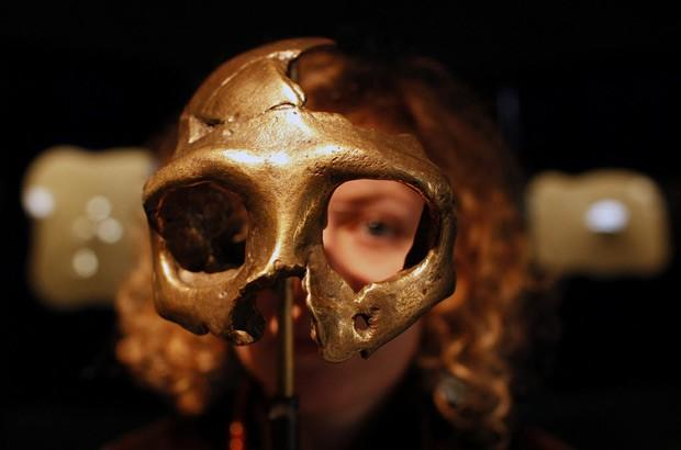 A girl looks through the replica of a neanderthal skull displayed in the Neanderthal Museum in Krapina, Croatia.