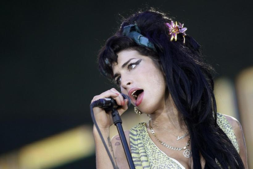 "British singer Winehouse performs during the ""Rock in Rio"" music festival in Arganda del Rey, near Madrid."