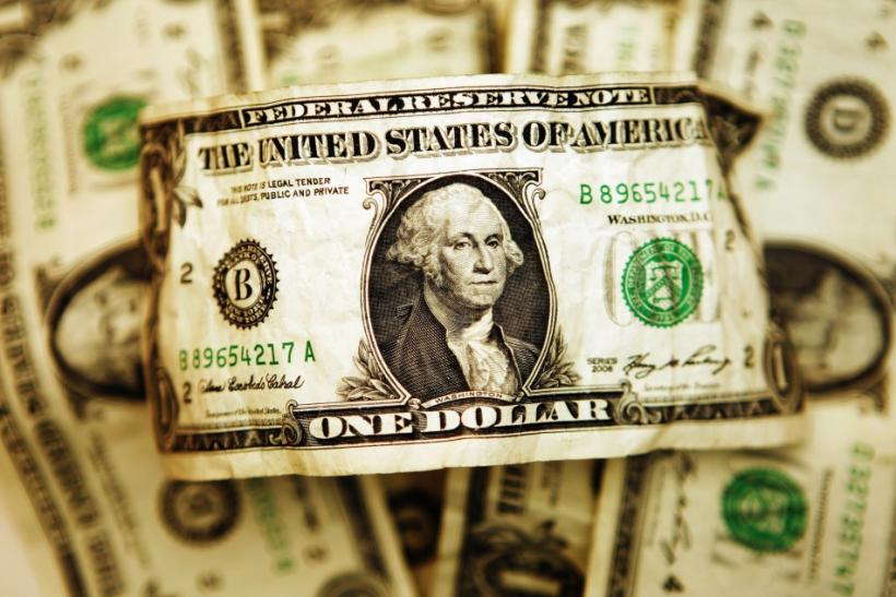 U.S. one dollar bills are displayed in this file photograph.