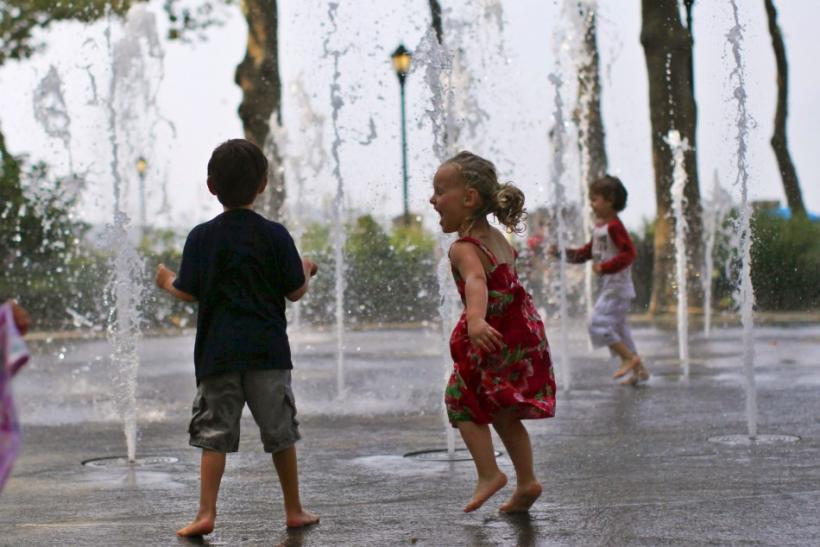 Children play in a fountain to cool off at New York City's Battery Park in lower Manhattan as heat wave spread over eastern U.S.