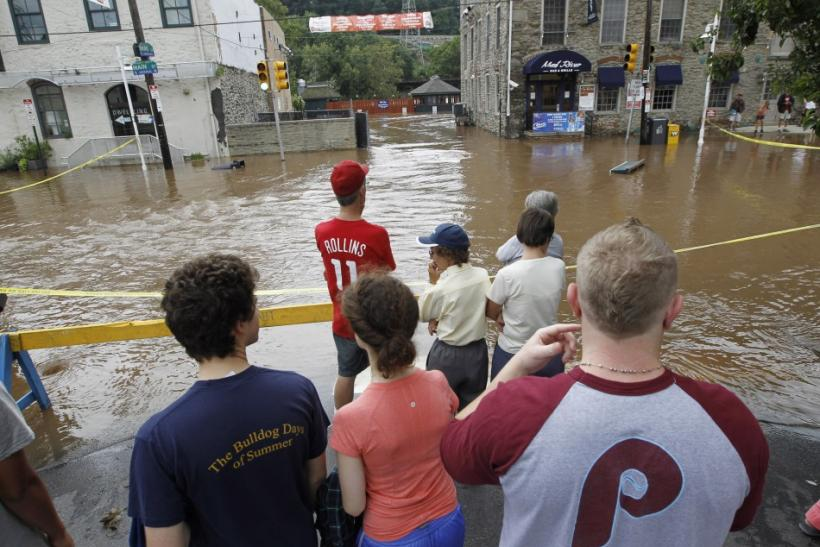 Residents watch the flooded streets in the Philadelphia neighborhood of Manayunk after Hurricane Irene