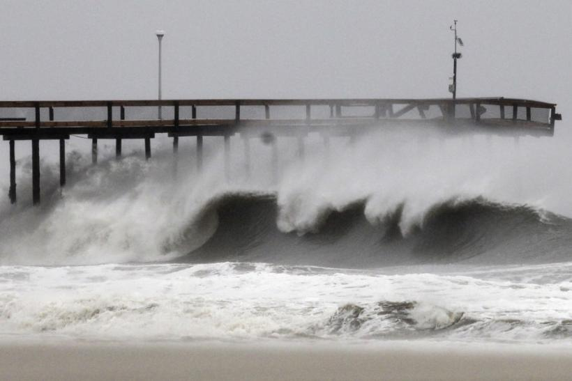 Waves break along the pier which was damaged during Hurricane Irene, in Ocean City