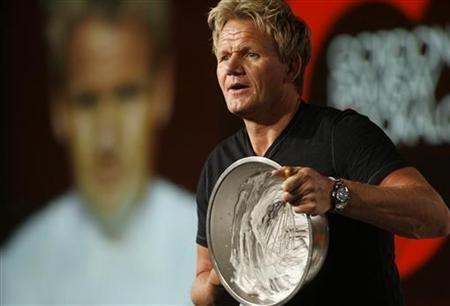 Chef Gordon Ramsay, star of the new program ''Gordon Ramsay: Cookalong Live'', whips egg whites as he makes Baked Alaska at the Fox Summer Television Critics Association press tour in Pasadena, California