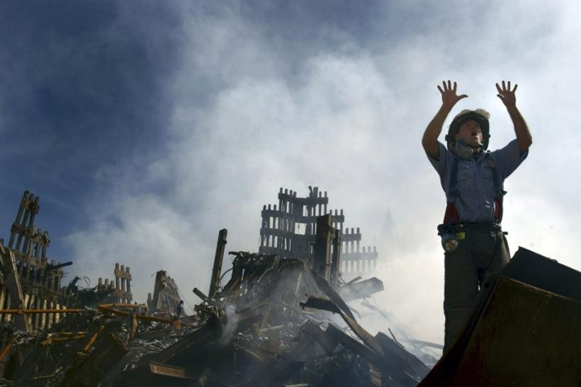 File picture shows a New York City fireman calling for more rescue workers to make their way into the rubble of the World Trade Center