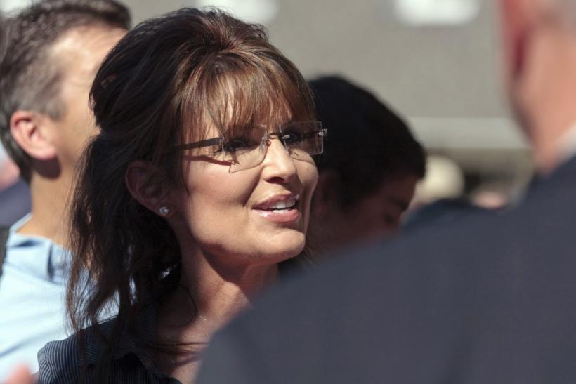 """Former Alaska governor Sarah Palin greets supporters as she arrives for the premiere of a documentary about her entitled """"The Undefeated"""" in Pella, Iowa"""