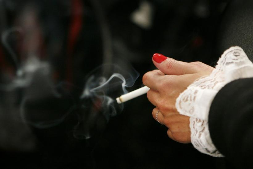 A model smokes backstage before the start of the Jenni Kayne fall fashion show during New York Fashion Week