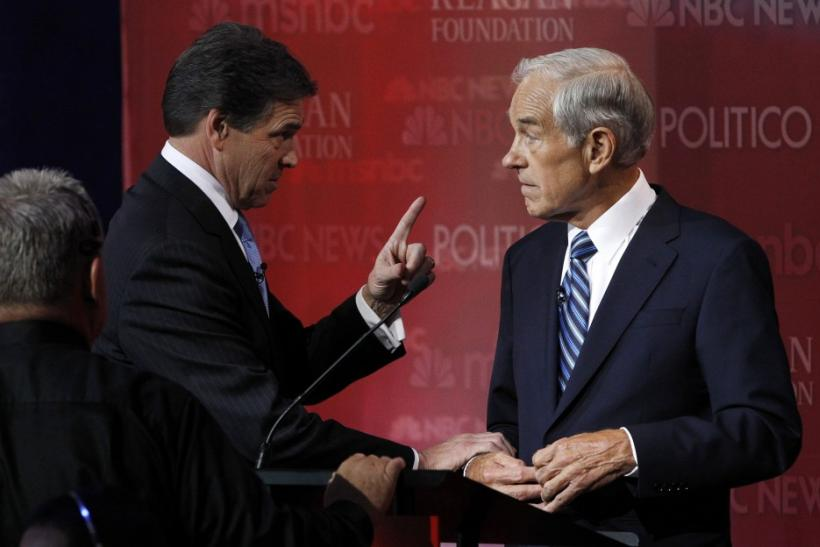 Texas Governor Perry talks during a break with Rep. Ron Paul on stage at the Reagan Centennial GOP presidential primary debate in Simi Valley