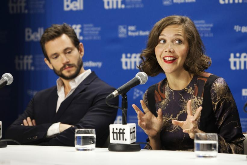 "Gyllenhaal speaks next to Dancy during the news conference for the film ""Hysteria"" during Toronto International Film Festival (TIFF) in Toronto"