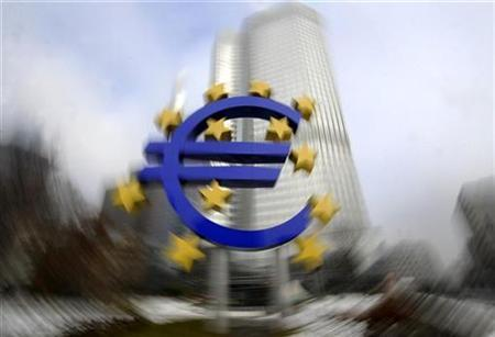 A euro sculpture is pictured in front of the headquarter of the European Central Bank (ECB) in Frankfurt