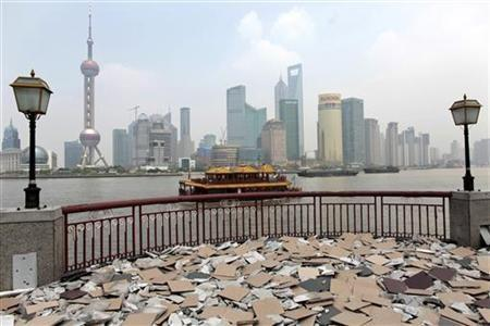Shanghai's new financial district skyline is seen from the opposite side of Huang Pu river.