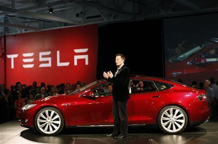 Tesla Motors CEO Elon Musk speaks next to the comany's newest Model S during the Model S Beta Event held at the Tesla factory in Fremont, California