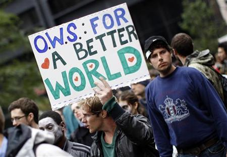 Demonstrator holds a sign during an Occupy Wall Street protest in lower Manhattan in New York