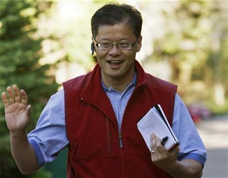 Jerry Yang, CEO of Yahoo! Inc waves at photographers as he arrives at the 26th annual Allen & Co conference in Sun Valley