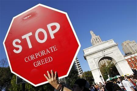 A protester holds a sign during an ''Occupy Wall Street'' rally in New York's Washington Square