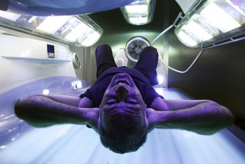 Man in tanning bed.