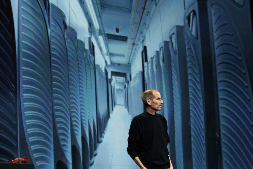 Steve Jobs is pictured with an image of server farm in Maiden, North Carolina as discusses the iCloud service at the Apple Worldwide Developers Conference in San Francisco