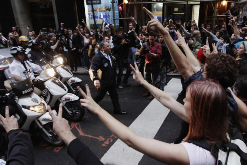 New York Police Department officers on motor scooters confront members of the Occupy Wall Street movement during a march through the financial district of New York