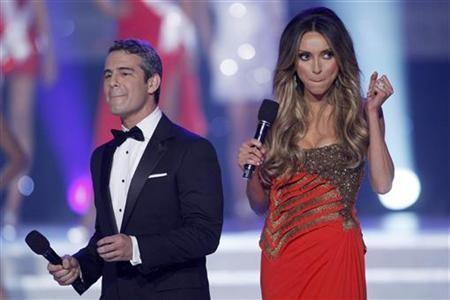 Andy Cohen (L) and Giuliana Rancic host the 2011 Miss USA pageant in the Theatre for the Performing Arts at Planet Hollywood Hotel and Casino in Las Vegas, Nevada