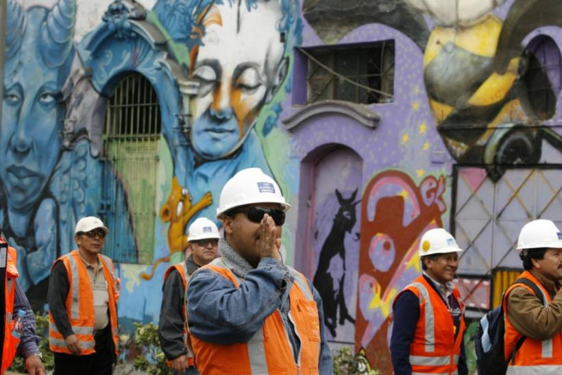 Cerro Verde miners protesting with graffiti in background