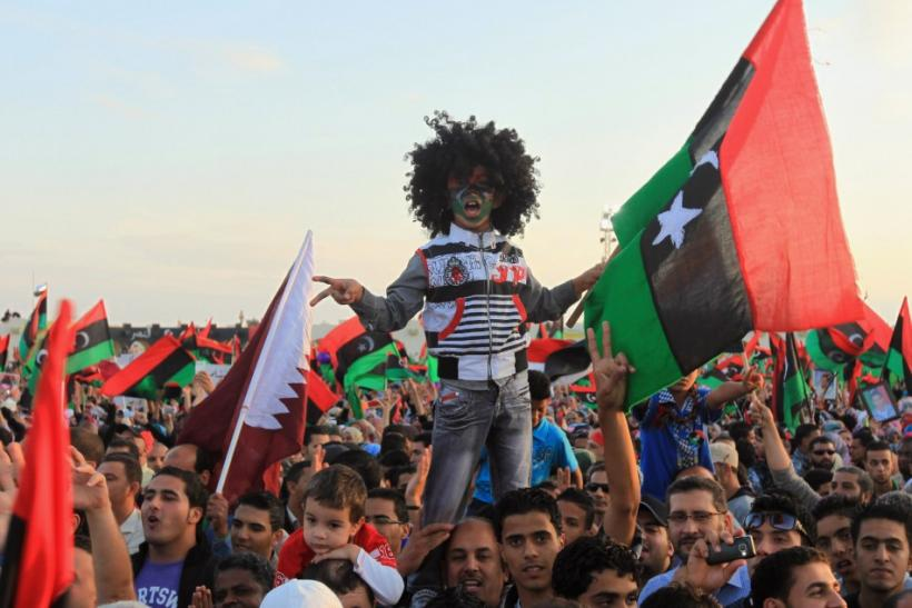 Libyan people with the Kingdom of Libya flags gather during celebrations for the liberation of Libya in Quiche, Benghazi October 23, 2011