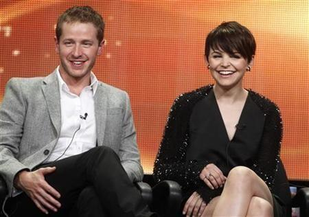 Actor Josh Dallas, who portrays Prince Charming, and actress Ginnifer Goodwin, who plays both Snow White and Sister Mary Margaret on new series ''Once Upon A Time'', smile during a panel session at the ABC Summer TCA Press Tour in Beve