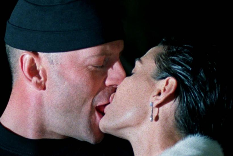 American actor Bruce Willis (L) kisses his wife Demi Moore (R) at the opening of one of their new ha..