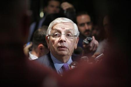 National Basketball Association commissioner David Stern (R) answers questions from members of the media outside the Louvell hotel in New York