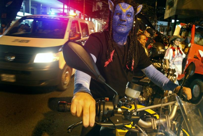 """A man dressed as a character from the movie Avatar takes part in the """"Moto Halloween Party 2010"""" in Cali"""
