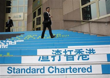 Several brokers downgrade their recommendations of Standard Chartered Tuesday. But one broker's suggestion stood out from the rest