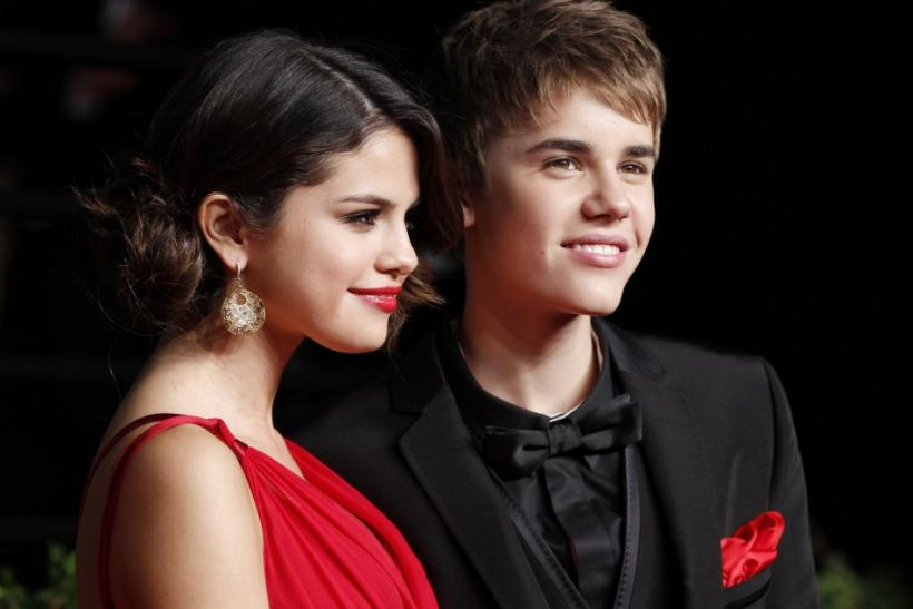 Justin Bieber and Selena Gomez arrive at the Vanity Fair Oscar party in West Hollywood