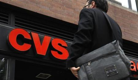 A man walks outside CVS pharmacy in New York City