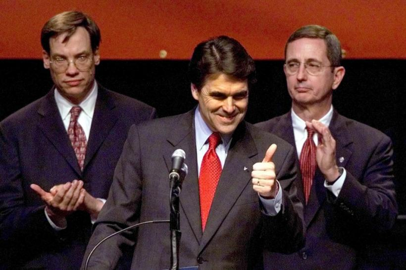 Texas Republican Governor Rick Perry (C) gives thumbs up to supporters during his victory speech in Austin, Texas, November 5, 2002.
