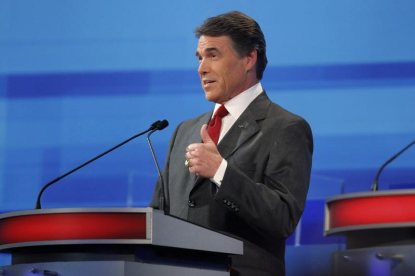 Texas Governor Rick Perry speaks during the Republican Party of Florida presidential candidates debate in Orlando, Florida, September 22, 2011.
