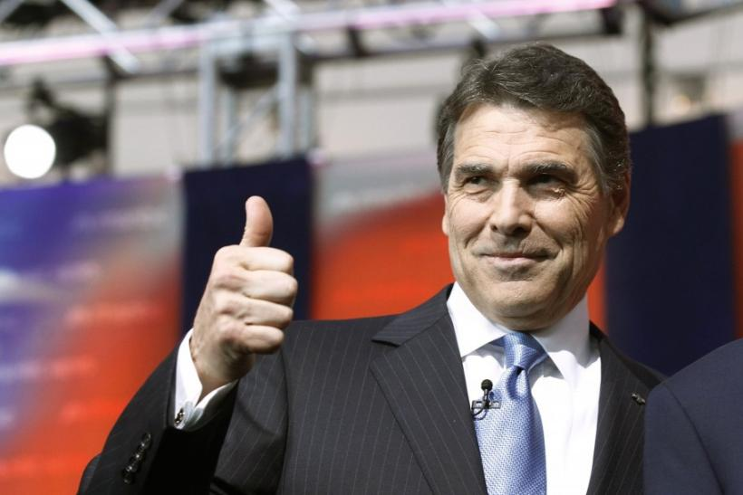 Texas Governor Rick Perry gives a thumbs up as he stands on stage before the Reagan Centennial GOP presidential primary debate at the Ronald Reagan Presidential Library in Simi Valley, California September 7, 2011.