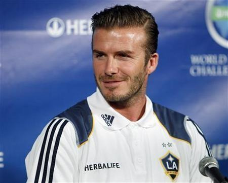 LA Galaxy's David Beckham attends a news conference to announce the Herbalife World Football Challenge 2011 soccer tournament in Los Angeles