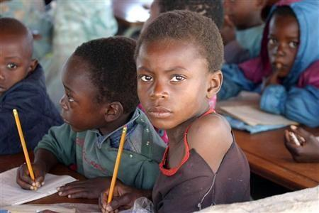 """Zambian children attend school in a poverty stricken area near the country""""s capital Lusaka"""